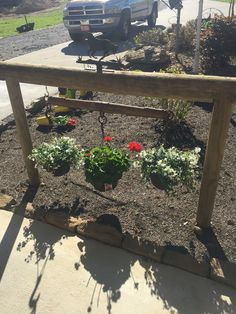 DIY Garden Decor Ideas for a Budget Backyard In front of barn hitching post with old harness Hanging baskets worked great Had originally thought name sign would be neat too