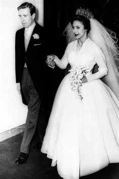 For her wedding on May 6, 1960, Princess Margaret chose a gown designed by Norman Hartnell. The bride wore a white silk organza dress with a short train, a Claude St Cyr of Paris veil and the Poltimore tiara. They were styled as the Earl and Countess of Snowdon. They had two children, but the couple divorced in 1978. Snowdon remarried, but was divorced again after it was discovered he fathered a child with another woman. Princess Margaret never remarried, and died from cancer in 2002.