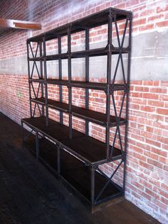 Vintage Industrial Ironworker Shelf / Bookcase / Fixture / French Retail. $6,950.00, via Etsy.