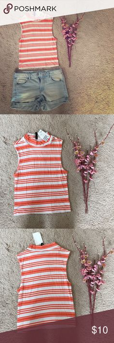 NWT H&M colorblock turtleneck tank NWT H&M color block turtleneck tank. Small. Orange and white. H&M Tops Tank Tops