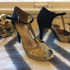Gold and black, T-strap heels, sparkly rhinestones Disco chic! Gold snakeskin on the front portion of the show. Peep-toe. Heel and strap are black suede. Heel is embellished with black rhinestones. Worn once! BCBGeneration Shoes Heels