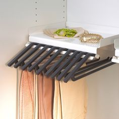 The innovative rack for storing trousers without creasing them Metal Shelves, Magnetic Knife Strip, Knife Block, Decorating Your Home, Innovation, Trousers, Design, Trouser Pants, Pants