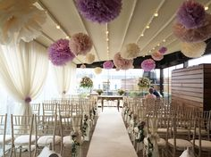 Blush, lavender and Ivory wedding decor and paper poms on the roof terrace of the Merchant hotel Belfast.