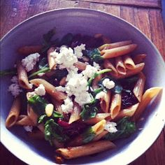Whole wheat penne,arugula, goat cheese, pine nuts, sun-dried tomatoes, so good, and healthy!