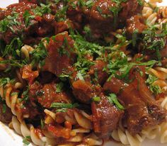 Hungarian goulash in slow cooker is my favorite recipe. Cubed beef steak with spices and vegetables cooked in slow cooker.
