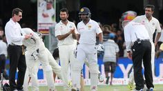 Kumar Sangakkara is clapped to the middle
