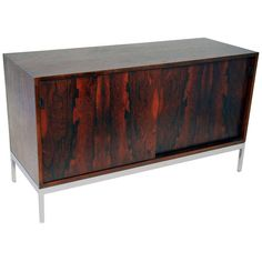 1stdibs.com | Florence Knoll Rosewood Sliding Door Credenza ca.1960's