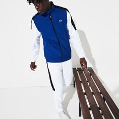 Light diamond taffeta and jersey lining compose this tracksuit made up of pants and a zippered jacket. Both pieces feature Lacoste lettering and a colourblock design. The elasticised finishes at the bottom of the pants, wristbands and an adjustable waist bring you the comfort you need. Lacoste Tracksuit, Mens Tracksuit, Site Master, Lacoste Sport, Track Suit Men, New Fashion Trends, Stand Up, Color Blocking, Blue And White