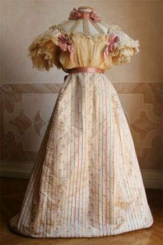 I adore this circa 1895 dress with puffy sleeves and pretty neck and bodice details.