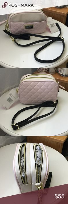 Betsey Johnson pink quilt xbody. Pink, white and black xbody. 2 entry pockets. One front pocket. Black and gold nameplate. Arm strap and wristlet. Gold accessories. 6in tall.8 inches from side to side. 4in wide. Great for makeup, phone, cameras. Many uses. Betsey Johnson Bags Crossbody Bags