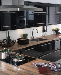 I have these high gloss cabinets but never considered the wood countertops.  love it!