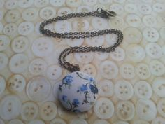 handmade white and blue floral button necklace on by maxollieandme