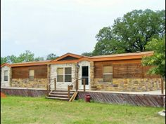 This is a great piece of property whether it be for pleasure training or raising animals Large 4-3 Rustic Custom Interior Designed home. Retro fitted and Exterior rocked Manufactured home Porch all the way around entire home fixing to be restained Lg storage by home 2 covered stalls with corral around it lg pond in back several lg arenas up front fenced all the property but also fencing that separates bulls and animals from home