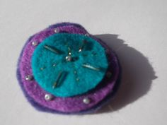 Handcrafted blue purple starburst beaded brooch by MadeByAmelie, £3.50