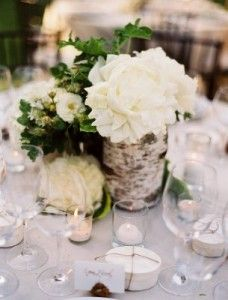 Earthy wedding- I like the birch wrapped around the flowers