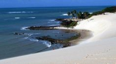 Genipabu is a beach with a complex of huge dunes and a lagoon in Natal, Rio Grande do Norte, Brazil.