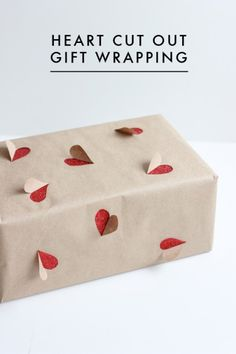 A clever wrapping paper DIY: first wrap in red, then cut out hearts on butcher paper.