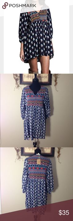 Umgee tunic day dress Cute printed tunic day dress in navy. Vented neckline, mid length sleeves and multicolored print. Pair this tunic with dark skinny jeans and ankle boots for a cute and stylish look. umgee Dresses