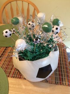 Soccer Centerpieces with Chocolate soccer balls, bouncey and eraser soccer balls