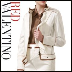 !!COUTURE!!! REDValentino Ruffed Jacket I typically am not someone who purchases high couture items, but while on a vacation I found myself in a posh little high-end boutique and saw this one sale so I went for my first haute couture experience. But I ended up not wearing it because it was a bit small. It is a leather trimmed off-white ruffled jacket. It is 98%  cotton and 2% elastin, so there is a bit of stretch. A great light-weight summer jacket. Valentino Jackets & Coats