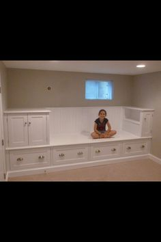 I would like something like this in my kids sitting room. Built in bed wall with drawers underneath.