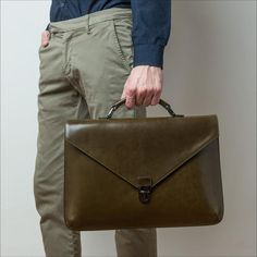 Classic and timeless premium vegetable tanned leather briefcase made in Italy. One of its hallmarks is the light grey lining made of outstanding extra soft South-Tyrolean Loden.  The bag features one large zip pocket on the back, a flap with a buckle fastener and a handle, as well as an adjustable and removable shoulder strap.  In addition, inside the bag, you will find two large compartments for your documents, laptops (up to 13'') or tablets plus a large zip pocket.