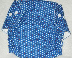 Cotton covered waterproof polyurethane.  Three snap sides with additional snap for the included soaker pad.  Use as a diaper or use as a diaper cover.  Additional soakers may also be purchased.