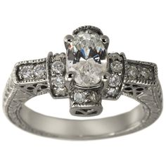 Vintage Oval Engagement Mounting With Milgrain And Scrollwork -  This engagement mounting can hold between a 0.90ct and a 1.20ct oval center diamond.      This ring has brilliantround diamonds which enhance the oval cut center diamond.         The engraving, milgrain and the open filigree work give it thedistinct appearance of vintage rings.         At Dacarli emphasis is placed on design, quality, and modern, high-tech manufacturing techniques. Our rings have thick and durable...