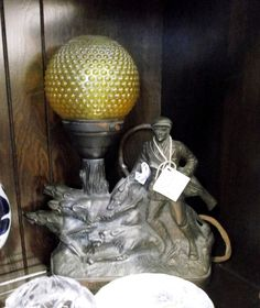 This great bronze lamp is hidden in a shelf in P405. For $225.00 it will be stunning lit on a mantle or buffet. 1400 Squires Beach Road, Pickering, ON L1W 4B9. 905) 427-7902. www.roadshowantiquespickering.com A Shelf, Shelves, Beach Road, Mantle, Buffet, Bronze, Lighting, Home Decor, Shelving
