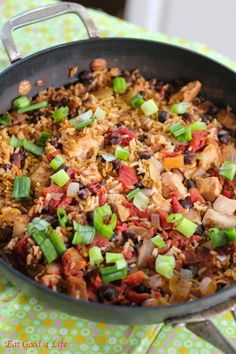 No-fuss Black Bean, Chicken and Rice 1.5 lbs of organic chicken, cut into small chunks 1 onion, chopped 1 15oz canned black beans, drained 1 14oz canned chopped tomatoes 2 tbsp Tabasco® original sauce, more if you like 3 green onions chopped 2 cups brown rice 2 tbsp olive oil 1 tsp salt