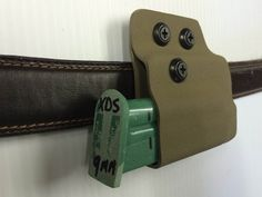 Horizontal Mag Carrier.  Only 3/4 of an inch below the belt.  Back up mag but still concealed and ready.  www.geartofit.com