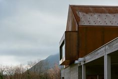 corten steel school in lugrin, france by ateliers o-s architectes overlooks lake geneva:… Paris Architecture, Contemporary Architecture, Architecture Design, Architecture Interiors, Architectural Writing, Larch Cladding, Mensa, School Equipment, Weathering Steel