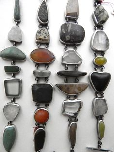 Bracelets by Indiana artist Terri Logan. She does the lapidary work on stones she finds in the area and sets them in silver alongside antique and modern rock crystal and other assorted stones and glass. Available at Good Goods in Saugatuck, Michigan.