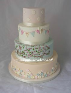 Pastel shades, bunting, hand painted cherry blossom, buttons and dots wedding cake