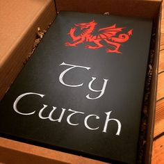 """It doesn't get much more Welsh than this! A Welsh slate house sign, deep engraved with a Welsh dragon! """"Ty Cwtch"""" is such a lovely name for a home."""