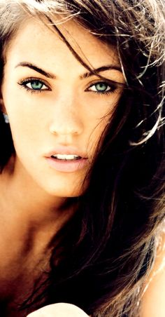 megan fox. Dark hair, blue eyes. She sums up fucking beautiful in my mind!