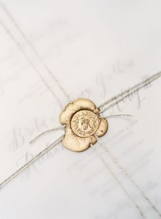 Gold wax seal: http://www.stylemepretty.com/2016/12/01/a-modern-take-on-minimalistic-these-simple-design-details-pack-a-stylish-punch/ Photography: O'Malley Photographers - http://omalleyphotographers.com/