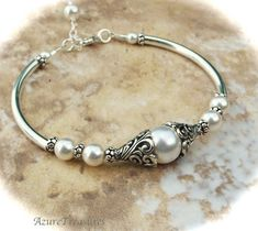 Bali Ivory Pearl Bracelet - replace pearls with beads I actually *like*! Pearl Jewelry, Wire Jewelry, Jewelry Crafts, Beaded Jewelry, Jewelry Box, Jewelery, Jewelry Bracelets, Jewelry Accessories, Handmade Jewelry