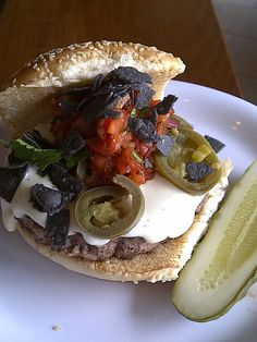 """It's """"nacho"""" average burger! The October Burger of the Month at Bobby's Burger Palace is the Nacho Burger! Topped with tomato-chipotle salsa, nacho cheese sauce, jalapenos and blue corn chips, it's sure to wake up your taste buds."""