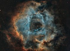 18 hours of data of the Rosette Nebula processed in a modified Hubble palette