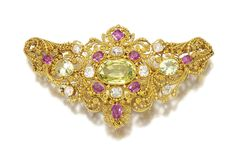 GEM SET AND DIAMOND BROOCH, EARLY 19TH CENTURY Composed of cannetille work set with oval pink sapphires and chrysoberyls, highlighted with cushion-shaped diamonds