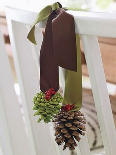 Elevate the look of seats in a jiff: Simply glue two pinecones (paint one green first) onto two contrasting ribbons. Tie the ribbons in a casual knot and drape over the chair's back.    Read more: Christmas Craft Decorations at WomansDay.com - Home Decor Craft Projects for the Holidays - Woman's Day