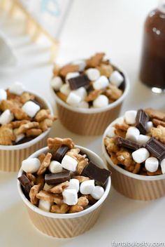 My kids LOVED this Camping Birthday Party indoors! The Smores trail mix was a hit, and easy to make. They especially loved the campfire cake too!