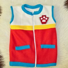 Fun vest for your little one to pretend to be just like Ryder from Paw Patrol. Vest is made from fleece and is unlined. Paw patch is felt. The zipper