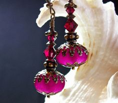 """Ruby Pink Crystal Jeannie Bottle Drop by TitanicTemptations, $32.00.  (""""Genie in a bottle"""", focal must be larger than 12mm.)"""