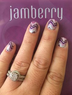 What are Jamberry Nails? I'm so glad you asked!!! They are high quality, vinyl, heat and pressure sealed nail wraps that last for weeks, at a fraction of the cost of a salon visit! No harsh chemicals, chipped polish, or damage to your natural or artificial nail. There are over 350 adorable style options! One sheet of nail wraps will give you up to 2 manis and 2 pedis