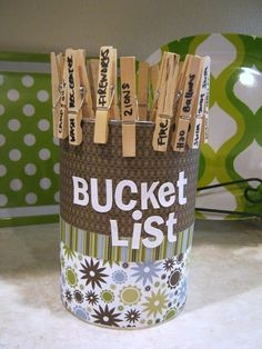 """DIY Bucket List/Can. Take a can, decorate it, and place clothespins in/on the can. Write the """"want to do"""" on the clothes pin."""