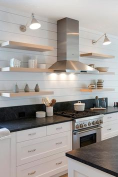 Lining the kitchen wall with shiplap, this wall becomes a farmhouse styled backsplash with blond floating shelves. Kitchen Shelf Design, Kitchen Wall Shelves, Floating Shelves Kitchen, White Kitchen Cabinets, Home Decor Kitchen, Kitchen Backsplash, New Kitchen, Backsplash Design, Kitchen Ideas