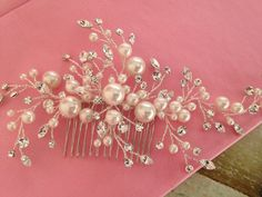 Really like this one!  Bridal Hair comb with Off White Crystal pearls by WEDDINGLASSOS, $78.00