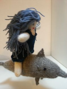 Calypso riding her dolphin Homer Odyssey, Knitted Dolls, Loom, Knitting Patterns, Crochet Hats, Wordpress, Character, Posts, Women